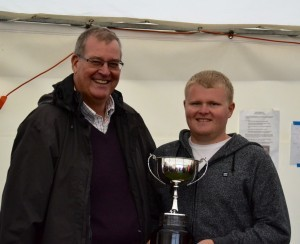 Rob Walsh (R) accepts the winners Trophy from Keith Coxon - image by Sue Brown