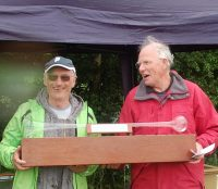 Dave Andrews (L) receives the 26 inch Trophy from Roger Stollery